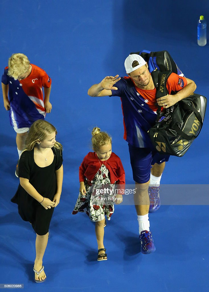 Lleyton Hewitt of Australia waves good bye to the crowd as he leaves the stadium with his kids after losing his second round match against David...