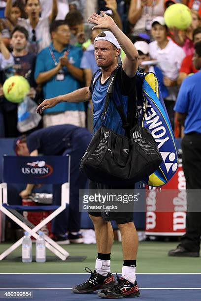 Lleyton Hewitt of Australia waves to the crowd after being defeated by Bernard Tomic of Australia during their Men's Singles Second Round match on...