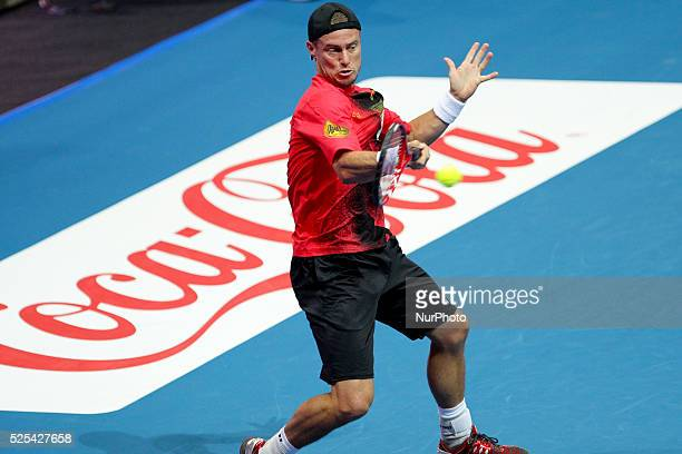 Lleyton Hewitt of the Singapore Slammers makes a forehand return to Gael Monfils of the Indian Aces during their singles match at the International...