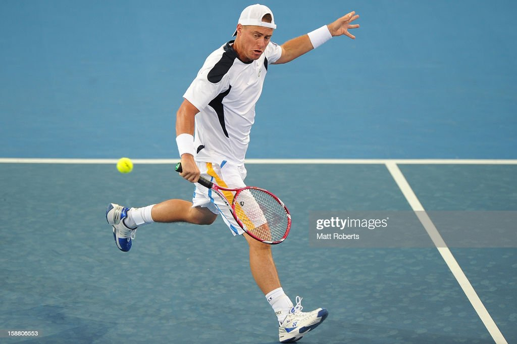 Lleyton Hewitt plays a backhand in his doubles match with Chris Guccione against Paul Hanley and Eric Butorac during day one of the Brisbane International at Pat Rafter Arena on December 30, 2012 in Brisbane, Australia.