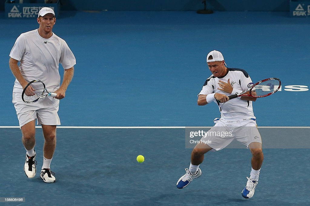 Lleyton Hewitt plays a forehand in his doubles match with Chris Guccione against Paul Hanley and Eric Butorac during day one of the Brisbane International at Pat Rafter Arena on December 30, 2012 in Brisbane, Australia.