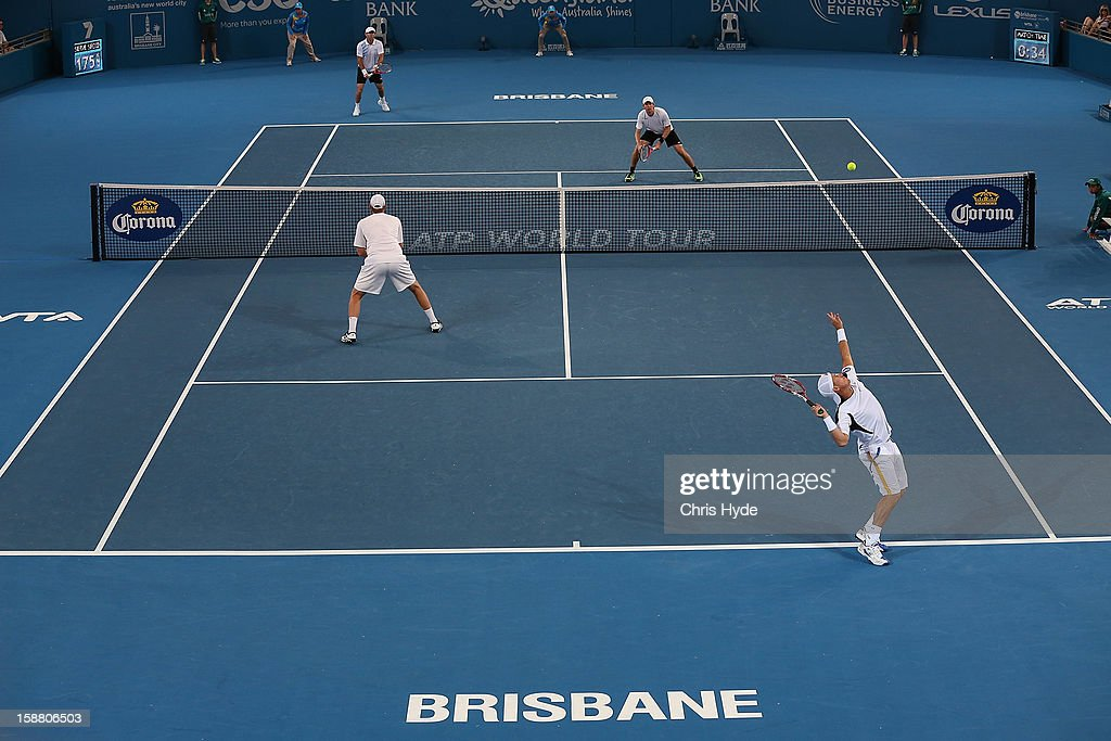 Lleyton Hewitt serves in his doubles match with Chris Guccione against Paul Hanley and Eric Butorac during day one of the Brisbane International at Pat Rafter Arena on December 30, 2012 in Brisbane, Australia.