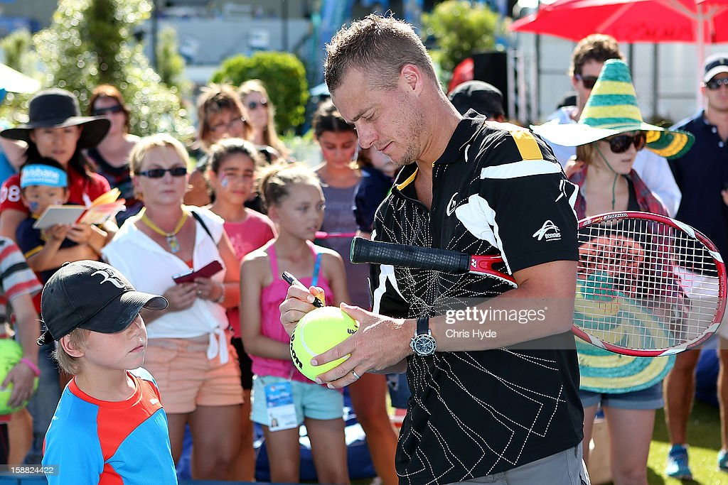 Lleyton Hewitt talks sign autographs during tennis hot shots on day two of the Brisbane International at Pat Rafter Arena on December 31, 2012 in Brisbane, Australia.