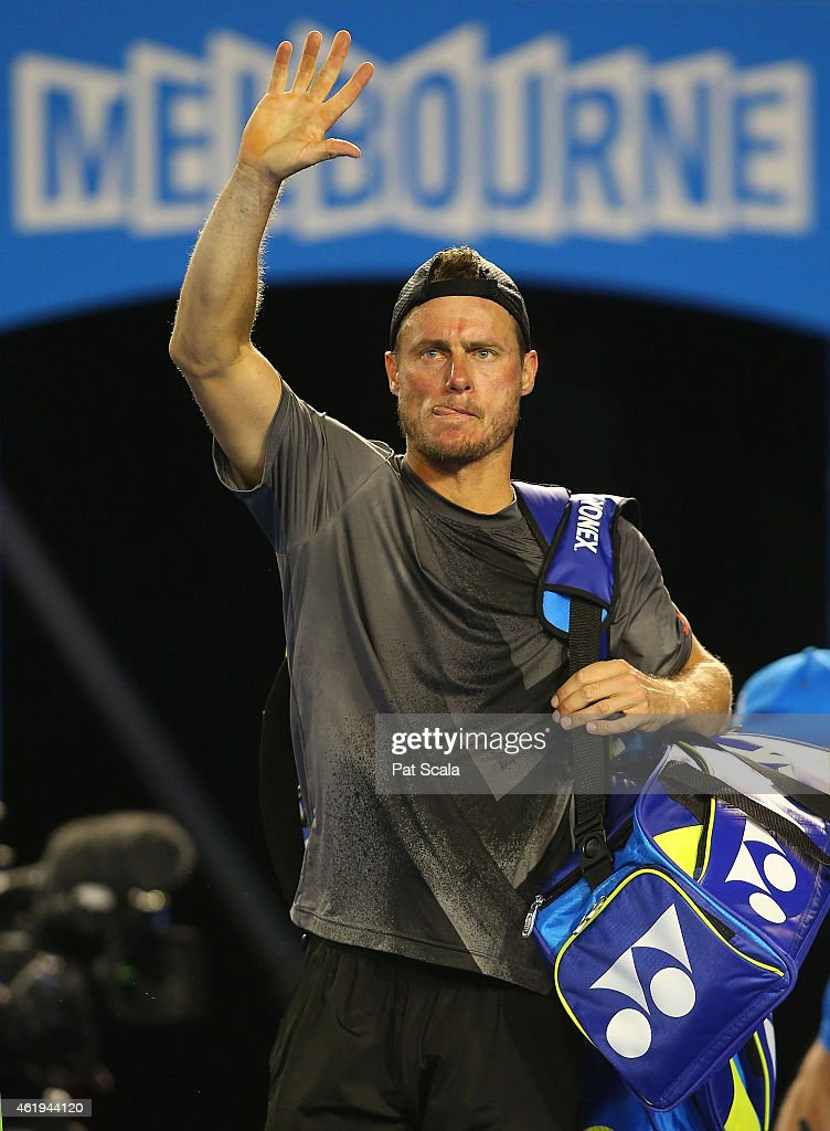 Lleyton Hewitt waves to the crowd after losing his match against Benjamin Becker on Rod Laver Arena during day four of the 2015 Australian Open at...