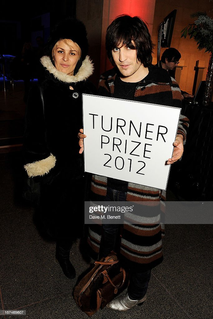 Lliana Bird (L) and Noel Fielding attend the Turner Prize 2012 winner announcement at the Tate Britain on December 3, 2012 in London, England.