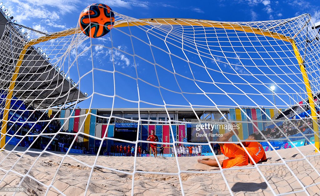 Llorenc Gomez of Spain (10) scores past goalkeeper Stefano Spada of Italy (1) in the penalty shoot out during the Men's Beach Soccer Group B match between Spain and Italy on day twelve of the Baku 2015 European Games at the Beach Arena on June 24, 2015 in Baku, Azerbaijan.