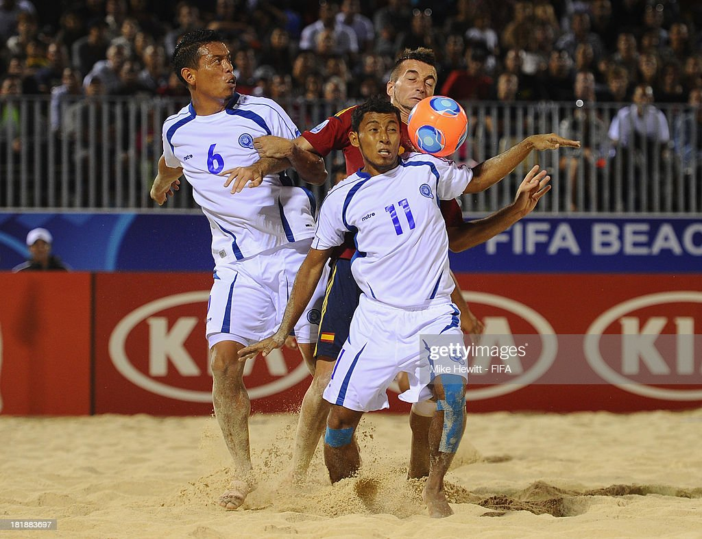 Llorenc of Spain battles with Elias Ramirez (6) and Frank Velasquez of El Salvador during the FIFA Beach Soccer World Cup Tahiti 2013 Quarter Final match between Spain and El Salvador on at the Tahua To'ata Stadium on September 25, 2013 in Papeete, French Polynesia.