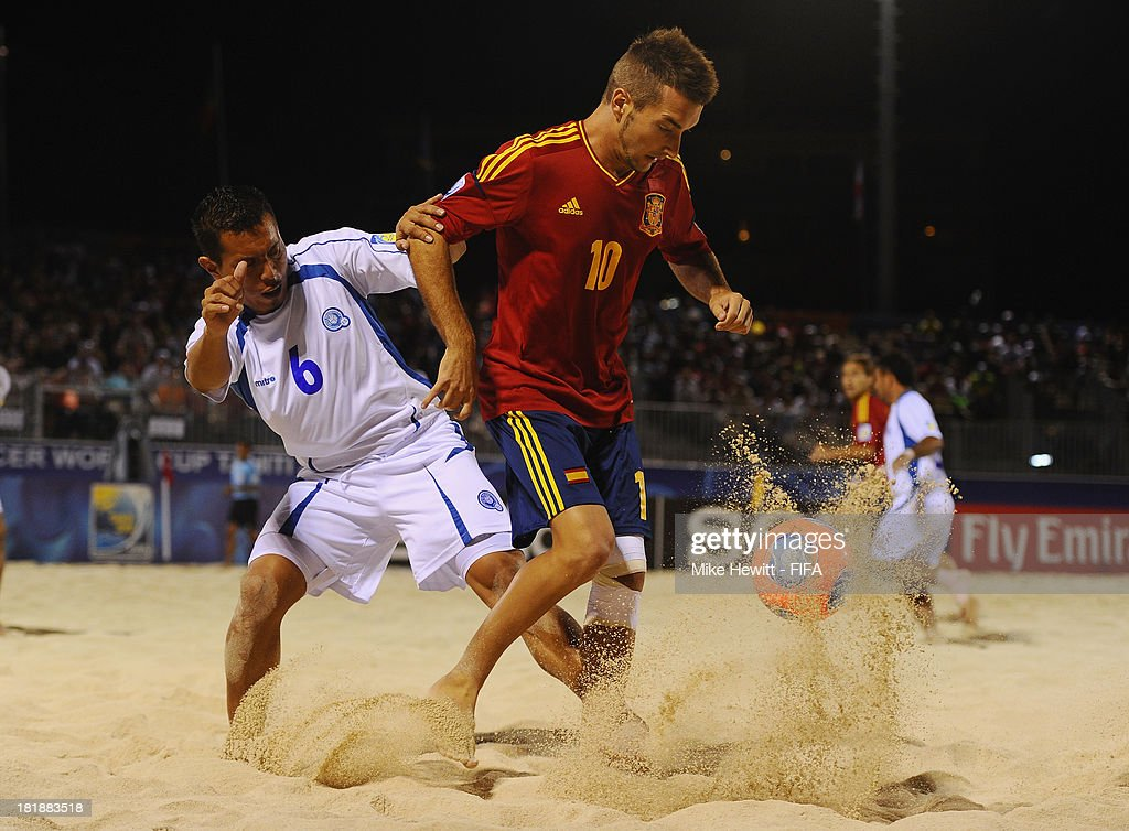 Llorenc of Spain holds off Elias Ramirez of El Salvador during the FIFA Beach Soccer World Cup Tahiti 2013 Quarter Final match between Spain and El Salvador on at the Tahua To'ata Stadium on September 25, 2013 in Papeete, French Polynesia.