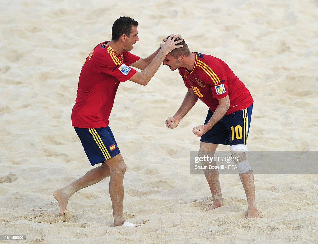 Llorenc of Spain is congratulated by team-mate Juanma after scoring during the FIFA Beach Soccer World Cup Tahiti 2013 Group A match between United Arab Emirates and Spain at the Tahua To'ata stadium on September 21, 2013 in Papeete, French Polynesia.