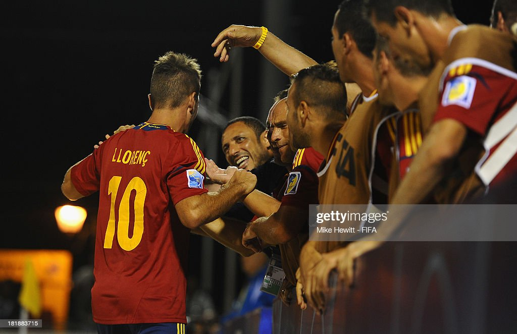 Llorenc of Spain is congratulated by the Spanish bench after scoring during the FIFA Beach Soccer World Cup Tahiti 2013 Quarter Final match between Spain and El Salvador on at the Tahua To'ata Stadium on September 25, 2013 in Papeete, French Polynesia.