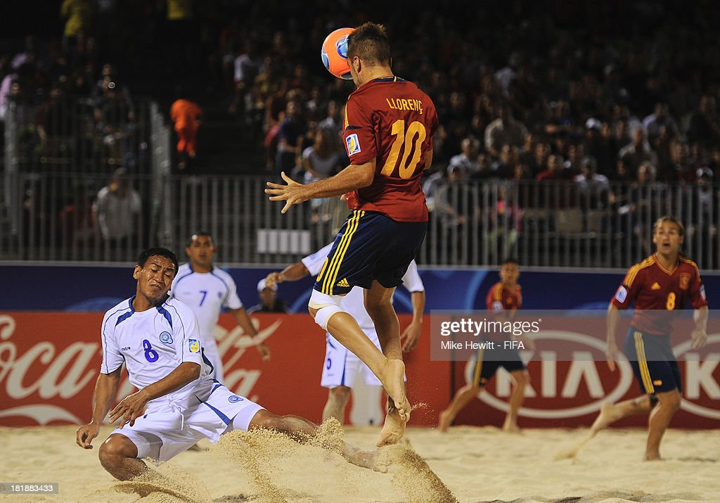 Llorenc of Spain scores with a header during the FIFA Beach Soccer World Cup Tahiti 2013 Quarter Final match between Spain and El Salvador on at the Tahua To'ata Stadium on September 25, 2013 in Papeete, French Polynesia.