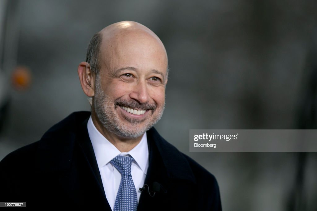 <a gi-track='captionPersonalityLinkClicked' href=/galleries/search?phrase=Lloyd+Blankfein&family=editorial&specificpeople=4085054 ng-click='$event.stopPropagation()'>Lloyd Blankfein</a>, chairman and chief executive officer of Goldman Sachs Group Inc., smiles during a television interview following a meeting with U.S. President Barack Obama at the White House in Washington, D.C., U.S., on Tuesday, Feb. 5, 2013. U.S. Obama urged Congress to postpone automatic spending cuts scheduled to begin March 1 to avoid 'real and lasting impacts' on U.S. economic growth. Photographer: Andrew Harrer/Bloomberg via Getty Images