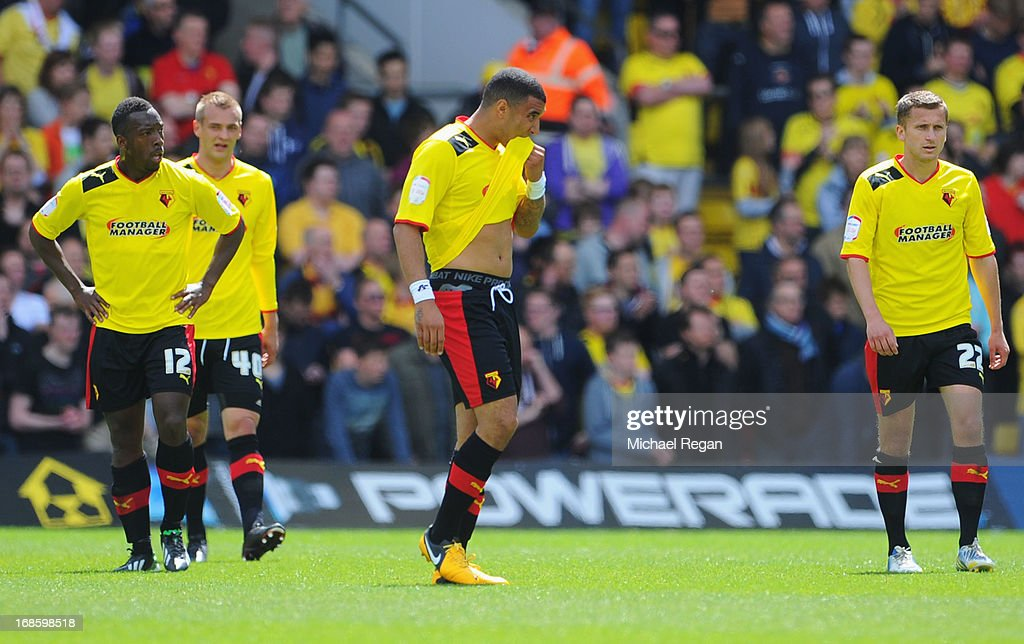 Lloyd Doyley, Joel Ekstrand, Troy Deeney and Almen Abdi of Watford look dejected as David Nugent of Leicester City (not pictured) scores their first goal during the npower Championship Play Off Semi Final Second Leg match between Watford and Leicester City at Vicarage Road on May 12, 2013 in Watford, England.