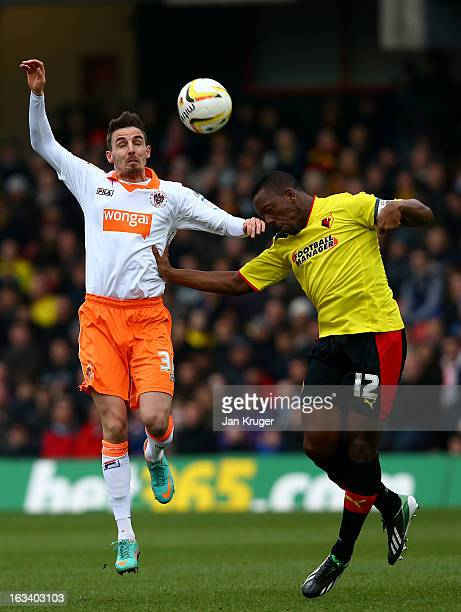 Lloyd Doyley of Watford and Matt Derbyshire of Blackpool challenge for the arial ball during the npower Champions match between Watford and Blackpool...