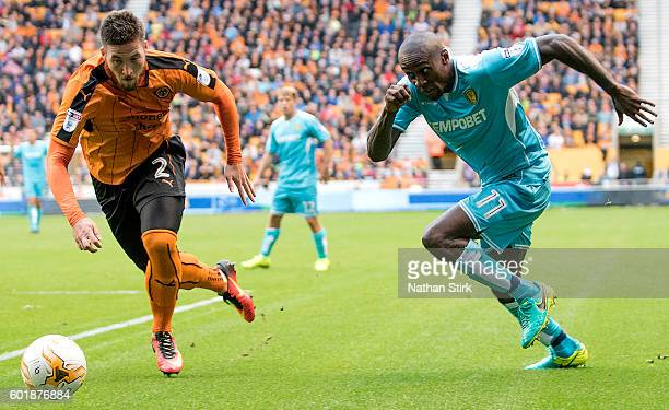 Lloyd Dyer of Burton Albion and Matt Doherty of Wolverhampton during the Sky Bet Championship match between Wolverhampton Wanderers and Burton Albion...