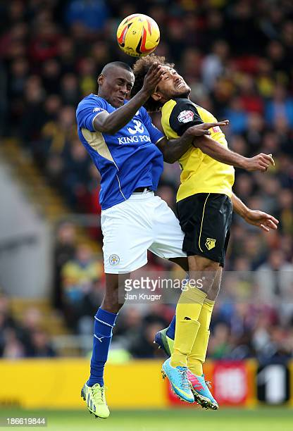 Lloyd Dyer of Leicester City and Ikechi Anya of Watford battles for the arial ball during the Sky Bet Championship match between Watford and...
