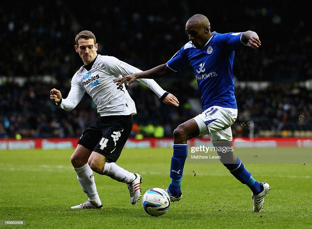 Lloyd Dyer of Leicester looks to beat Craig Bryson of Derby during the npower Championship match between Derby County and Leicester City at Pride Park Stadium on March 16, 2013 in Derby, England.