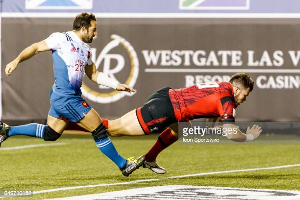 Lloyd Evans of Wales scores during the Pool A match between Wales and France at the HSBC Rugby Sevens Series held in Sam Boyd Stadium on March 03...