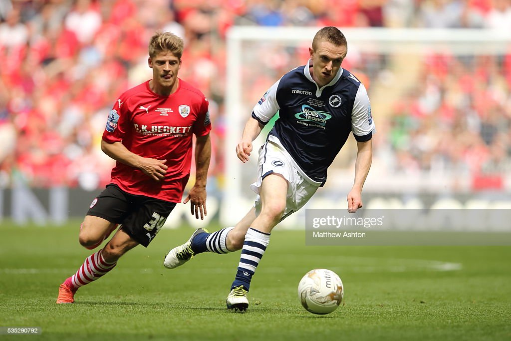 Lloyd Isgrove of Barnsley and <a gi-track='captionPersonalityLinkClicked' href=/galleries/search?phrase=Shane+Ferguson&family=editorial&specificpeople=7175102 ng-click='$event.stopPropagation()'>Shane Ferguson</a> of Millwall during the Sky Bet League One Play Off Final between Barnsley and Millwall at Wembley Stadium on May 29, 2016 in London, England.
