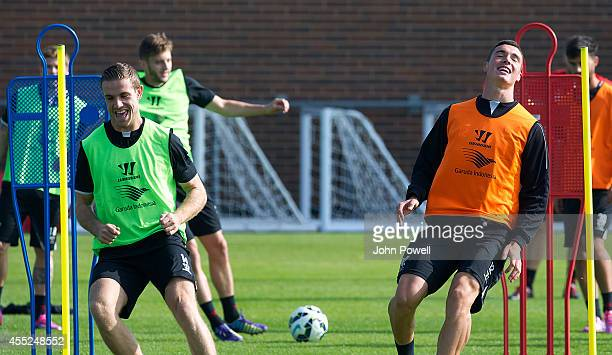 Lloyd Jones and Jordan Henderson of Liverpool in action during a training session at Melwood Training Ground on September 11 2014 in Liverpool England
