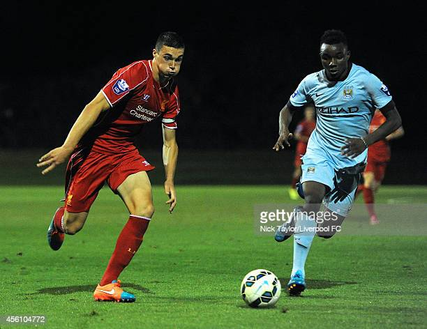 Lloyd Jones of Liverpool and Thierry Ambrose of Manchester City in action during the Barclays Premier League Under 21 fixture between Liverpool and...