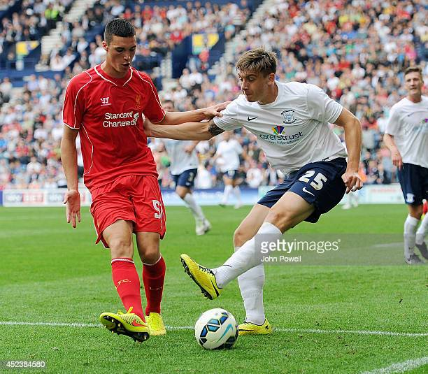 LLoyd Jones of Liverpool competes with Jordan Hugill of Preston North End during the Pre Season friendly match between Preston North End and...