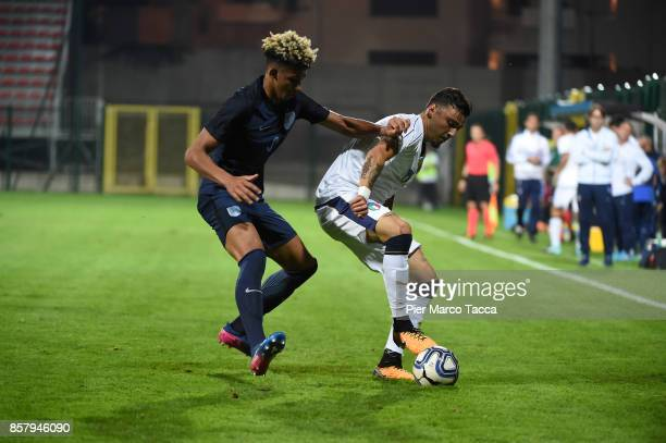 Lloyd Kelly of England U20 competes for the ball with Giulio Maggiore of Italy U21 during the 8 Nations Tournament match between Italy U20 and...