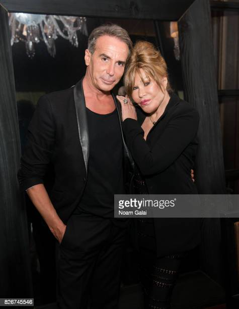 Lloyd Klein and Jocelyn Wildenstein pose for a photo at Baccarat Hotel on August 5 2017 in New York City