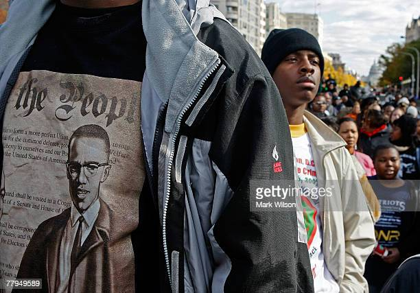 Lloyd Marshall wears a Malcolm X shirt while participating in a march around the Department of Justice to protest hate crime issues November 16 2007...
