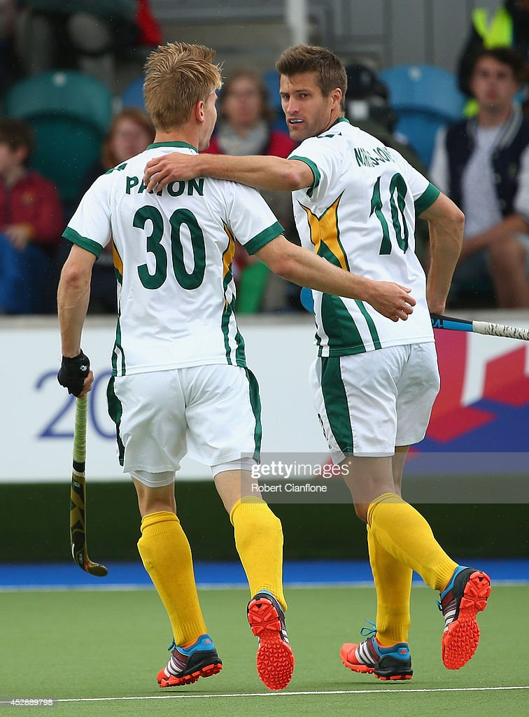 Lloyd Norris-Jones of South Africa celebrates with Taine Paton after he scored a goal during the men's preliminaries match between Wales and South Africa at the Glasgow National Hockey Centre during day six of the Glasgow 2014 Commonwealth Games on July 29, 2014 in Glasgow, United Kingdom.