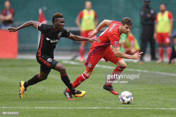 Lloyd Sam of DC United goes after Luis Solignac of Chicago Fire for the ball during a MLS Soccer game at RFK Stadium on May 20 2017 in Washington DC...