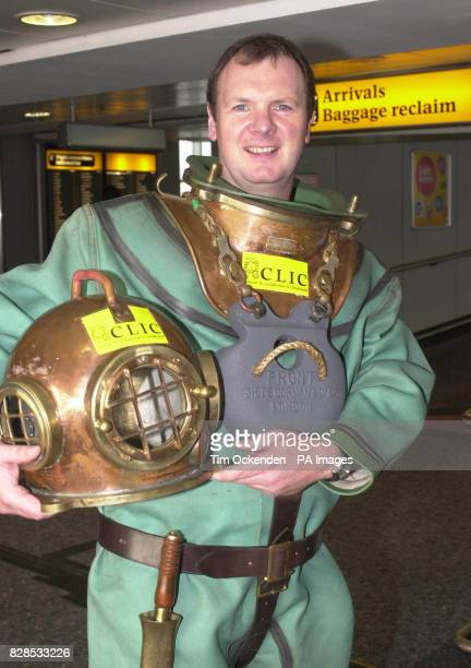 Lloyd Scott the deep sea diver who took more then four days to complete the London Marathon dressed in his 150lb deep sea diving suit leaves Heathrow...