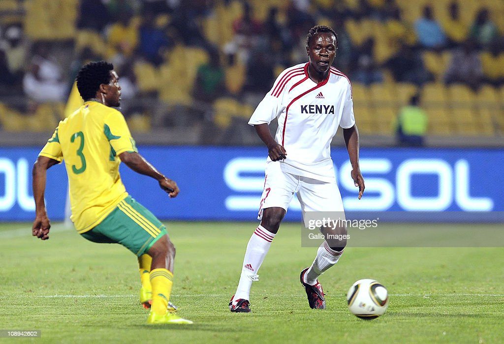 Lloyd Wahoma (L) of South Africa and Kevin Omondi of Kenya compete during the International friendly match between South Africa and Kenya at Royal Bafokeng Stadium on February 09, 2011 in Rustenburg, South Africa.