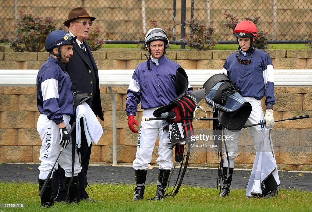 Lloyd Williams (owner) talks to jockeys Eddie Cassar, <a gi-track='captionPersonalityLinkClicked' href=/galleries/search?phrase=Brett+Prebble&family=editorial&specificpeople=646298 ng-click='$event.stopPropagation()'>Brett Prebble</a> and Nicholas Hall (r) after his International runners galloped before Melbourne Racing at Moonee Valley Racecourse on August 24, 2013 in Melbourne, Australia.