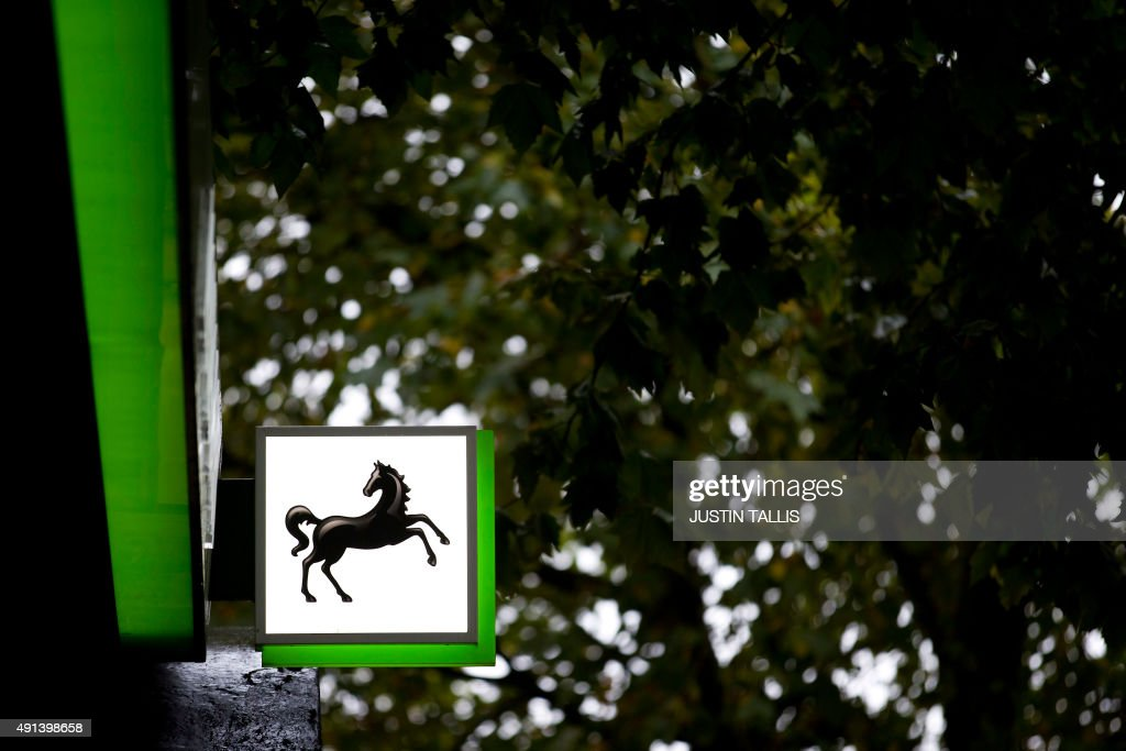 A Lloyds logo sits on a sign as it hangs outside a branch of a Lloyds bank in central London on October 5 2015 Britain will sell another £20 billion...
