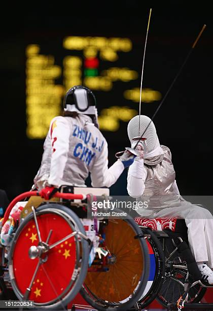 Lludmila Vasileva of Russia in action against Jingjing Zhou of China in the Women's Individual Foil Cat B Preliminaries of the Wheelchair Fencing on...