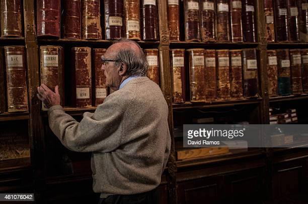 Lluis Castello owner of Musical Emporium takes a box of musical scores during his last day open to the public on January 5 2015 in Barcelona Spain...