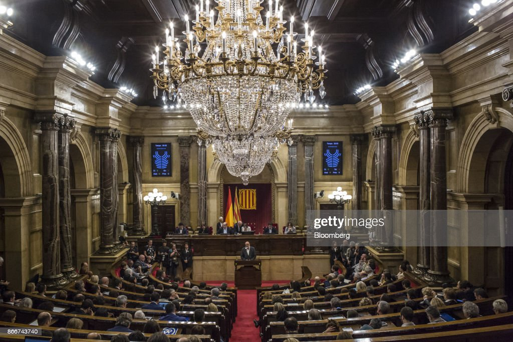 Lluis Corominas, spokesman of Junts Pel Si or 'Together for Yes' party, center, speaks during a parliament session in Barcelona, Spain, on Thursday, Oct. 26, 2017. Catalonian President Carles Puigdemont says he won't call a regional election that could have defused tension with Spain. Photographer: Angel Garcia/Bloomberg via Getty Images