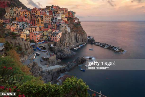 lluminated Manarola Town By Sea Against Sky During Sunset