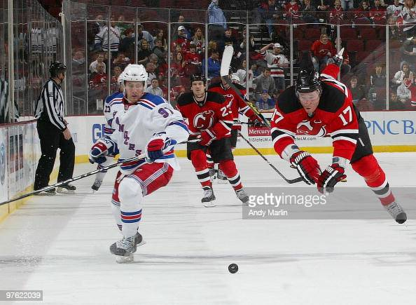 llya Kovalchuk of the New Jersey Devils avoids a check by Matt Gilroy of the New York Rangers during the game at the Prudential Center on March 10...