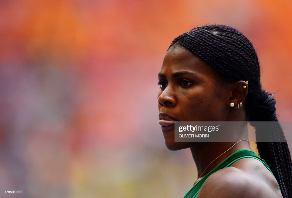 (LNigeria's Blessing Okagbare reacts after the women's 200 metres event at the 2013 IAAF World Championships at the Luzhniki stadium in Moscow on August 15, 2013.