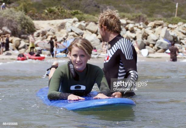 CARPINTERIA CA JUNE 13 Lo Bosworth and Thomas Whitaker during the Oakley Learn to Ride fueled by Muscle Milk Surf Camp at Carpinteria State Beach in...