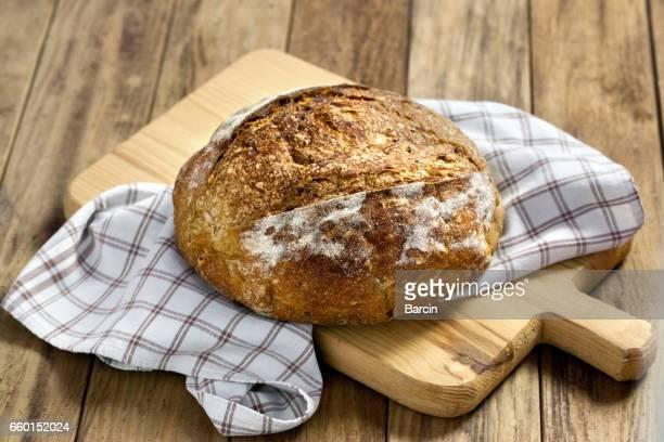 Load of bread on cutting board