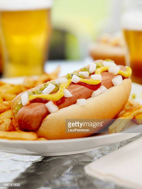 Loaded Hotdog with a Couple of Beers