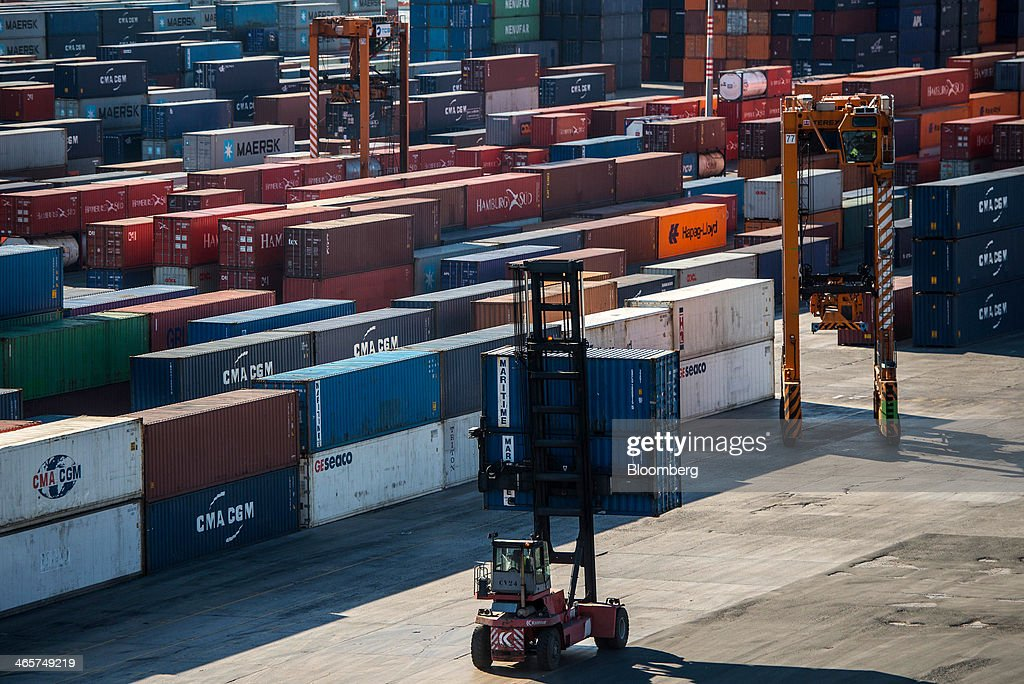 A loader carries two shipping containers to a storage site at the commercial port in Barcelona, Spain, on Wednesday, Jan. 29, 2014. Government bonds in Europe's most-indebted countries rallied in the first three weeks of the year on signs the debt crisis that pushed those nations' borrowing costs to euro-era records had abated. Photographer: David Ramos/Bloomberg via Getty Images