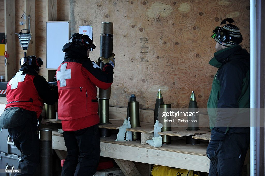 Loader Jeff Campbell prepares rounds to be shot out of the howitzer Elite Telluride ski patrollers this year have begun using a WWII Howitzer loaned...