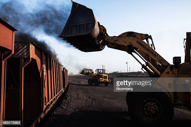 Loaders fill railcar wagons with coal at a depot operated by Coal India Ltd subsidiary Bharat Coking Coal Ltd in Jharia Jharkhand India on Sunday...