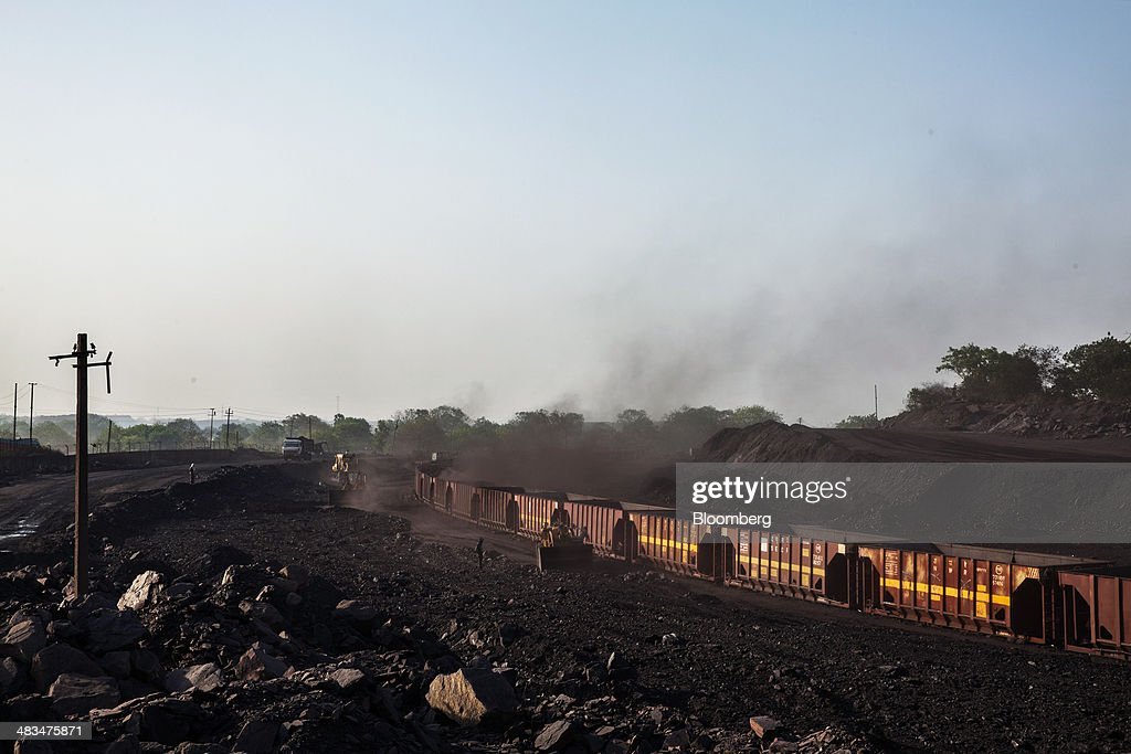 Loaders fill railcar wagons with coal at a depot, operated by Coal India Ltd. subsidiary Bharat Coking Coal Ltd. (BCCL), in Jharia, Jharkhand, India, on Sunday, April 6, 2014. Coal India, the worlds largest producer, estimates on its website that the nation faces a supply deficit of 350 million tons by 2016-2017, thereby overtaking import demand from China, the worlds biggest coal consumer and producer. Photographer: Sanjit Das/Bloomberg via Getty Images