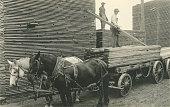 Loading Lumber on HorseDrawn Wagon
