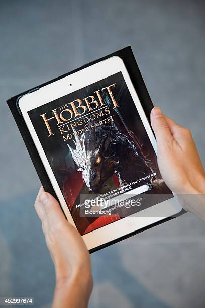 Kingdoms Of MiddleEarth developed by Kabam Inc is displayed on an Apple Inc iPad Mini in an arranged photograph in Hong Kong China on Friday Aug 1...
